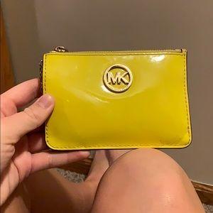 yellow Michael Kors key card wallet